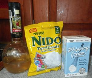Powdered milk (Nido), heavy cream, and white wine vinegar for the rich ricotta recipe.