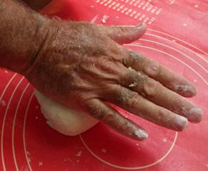After mixing in the water the tortilla dough is kneaded for about 3 minutes until smooth and elastic.