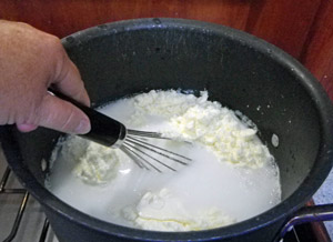 The powdered milk is dissolved in the pot.