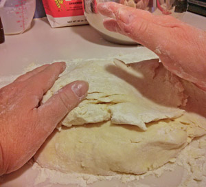 The dough is lightly kneaded and shaped to the right thickness.