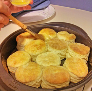 After baking the biscuits are brushed with melted butter.