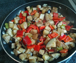 Sauteing vegetables for caponata.