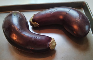 Eggplant are pierced before roasting.
